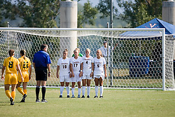 Virginia Cavaliers F/M Kelly Quinn (10), Virginia Cavaliers M/F Sinead Farrelly (17), Virginia Cavaliers M Jen Redmond (4), and Virginia Cavaliers M/F Shannon Foley (5) form a wall to defend on a W&M free kick outside of the 18 yard box.  The Virginia Cavaliers women's soccer team defeated the William and Mary Tribe 1-0 in double overtime at Klockner Stadium in Charlottesville, VA on September 23, 2007.
