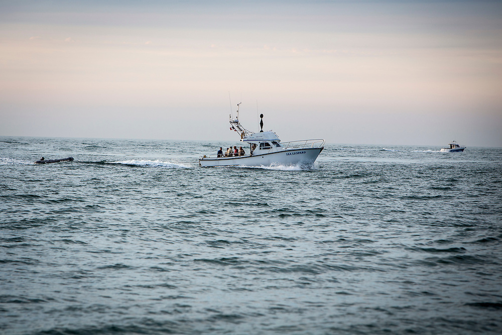 The Sea Leopard, a licensed charter boat, pulling a black rigid inflatable boat leaves Dover Harbour and sails in the Strait of Dover, Kent, England, United Kingdom . Passengers on the boat are Channel swimmers and crew.  (photo by Andrew Aitchison / In pictures via Getty Images)