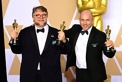 Guillermo Del Toro and J. Miles Dale with their Best Picture Oscar for The Shape of Water in the press room at the 90th Academy Awards held at the Dolby Theatre in Hollywood, Los Angeles, USA. PRESS ASSOCIATION Photo. Picture date: Sunday March 4, 2018. See PA Story SHOWBIZ Oscars. Photo credit should read: Ian West/PA Wire