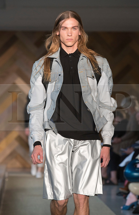 © Licensed to London News Pictures. 29/05/2014. London, England. Collection by Ellen Pedersen. 30 students of the Royal College of Art's prestigious MA Fashion programme presented their final collections in  a runway show at the RCA building in Kensington. Photo credit: Bettina Strenske/LNP