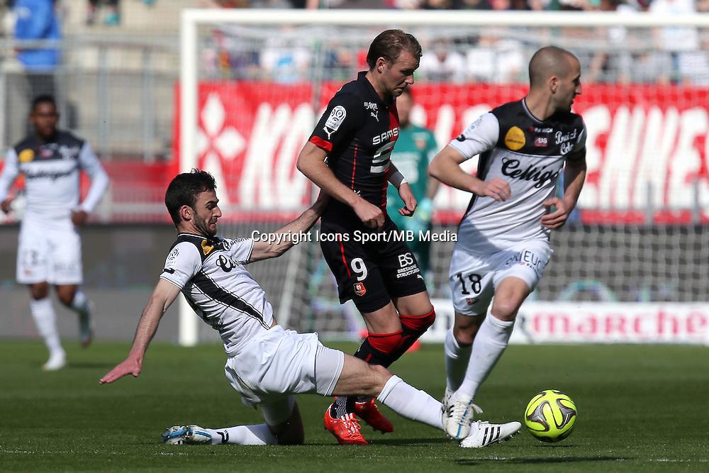 Ola TOIVONEN / Christophe KERBRAT - 12.04.2015 - Rennes / Guingamp - 32eme journee de Ligue 1 <br />Photo : Vincent Michel / Icon Sport