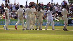November 7, 2018 - Galle, Sri Lanka - Sri Lankan cricket captain Dinesh Chandimal leaves the field as England players celebrate his dismissal during the 2nd day's play of the first test cricket match between Sri Lanka and England at Galle International cricket stadium, Galle, Sri Lanka. 11-07-2018  (Credit Image: © Tharaka Basnayaka/NurPhoto via ZUMA Press)
