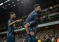 Football - 2018 / 2019 FA Cup - Fourth Round: Arsenal vs. Manchester United <br /> <br /> Fred (Manchester United) leaps onto the back of goalscorer Anthony Martial (Manchester United) at The Emirates Stadium.<br /> <br /> COLORSPORT/DANIEL BEARHAM