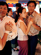 "Dancers at Lao ""naming"" ceremony for newborn child."