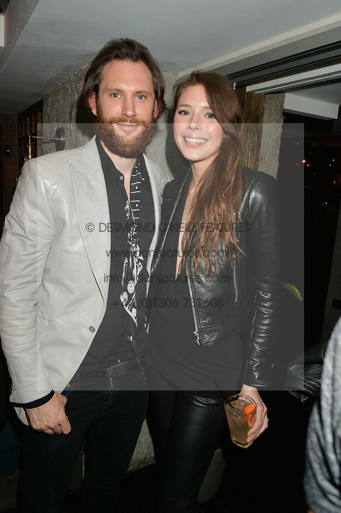 MARC BURTON and MAGDALENA McNAB at the launch of Geisha at Ramusake hosted by Piers Adam and Marc Burton at Ramusake, 92B Old Brompton Road, London on 11th June 2015.