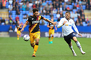 Bolton Wanderers striker Jamie Proctor (9) tries to get around Bradford City defender Nat Knight-Percival (22) during the EFL Sky Bet League 1 match between Bolton Wanderers and Bradford City at the Macron Stadium, Bolton, England on 24 September 2016. Photo by Simon Brady.