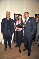 Left to right, MARK SHAND brother of the Duchess of Cornwall, The COUNTESS OF WEMYSS and THOMAS GIBSON at a party to launch the Indian Head Injury Foundation held at Thomas Gibson Fine Art Ltd. 31 Bruton Street, London on 16th June 2009
