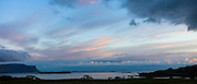 Panoramic sky scene view of pink and blue pastel colours over Loch Na Keal at sunset on Isle of Mull, the Inner Hebrides and Western Isles in West Coast of Scotland