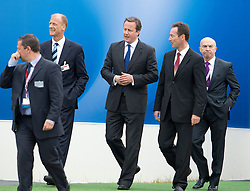 © London News Pictures. 09/07/2012. Farnborough, UK. British Prime Minister David cameron (centre) with Tom Enders, CEO of EADS (second from left) and Fabrice Bregier CEO of Airbus (second from right) on a walk round of aircraft on day one of the Farnborough International Airshow, in Farnborough, Hampshire, UK on July 9, 2012. FIA is a seven-day international trade fair for the aerospace industry which is held every two years at Farnborough Airport . Photo credit: Ben Cawthra/LNP.