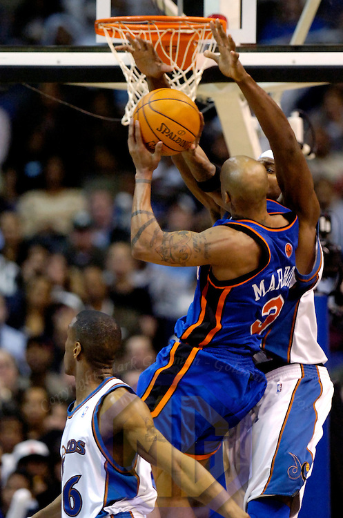 10 March 2007:   New York Knicks guard Stephon Marbury (3) scores 2 of his 15 point in the first half against Washington Wizards center Brendan Haywood (33) at the Verizon Center in Washington, D.C.  The Knicks defeated the Wizards 90-89.