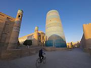 Uzbekistan, Khiva, Ichon-Qala.<br /> Islom-Hoja Minaret at sunrise.