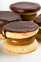 Close up of cornflour cookies filled with caramel and covered with Chocolate.