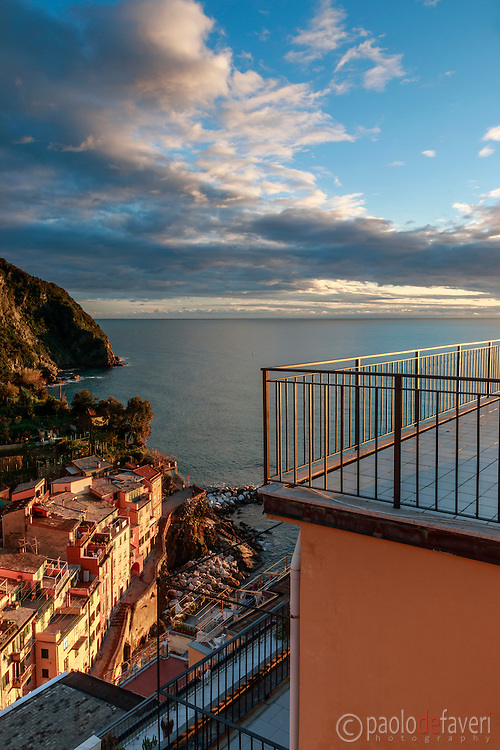 """Some beautiful warm light at sunset by the Marina of Riomaggiore. Taken from the terrace of the b&b """"La Baia di Rio"""""""