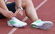 POTCHEFSTROOM, SOUTH AFRICA, Saturday 24 March 2012, LJ van Zyl puts on his Adidas spikes before the start of the 400m for men during the Yellow Pages Series 2 athletics meeting at the McArthur Stadium..Photo by Roger Sedres/Image SA