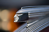 Bellmore, New York, USA. 11th August 2017.  Hood ornament closeup is shown of 1938 Pontiac 2-door sedan parked at the Bellmore Friday Night Car Show.