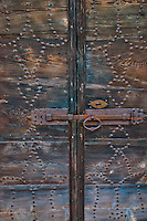 Close-up of an old wooden door and iron work at the church in Aurigeno, Ticino, Switzerland.