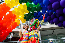 © Licensed to London News Pictures. 06/07/2019. London, UK. Two participants under rainbow coloured balloons during the annual Pride Parade in central London. Photo credit: Dinendra Haria/LNP