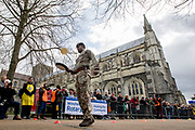 UNITED KINGDOM, Winchester: 05 March 2019 Winchester Pancake Race Photo Feature:<br /> A member of the team 'Fipping Military' competes in the Inaugural Winchester Pancake Race earlier this afternoon on Shrove Tuesday. The race, which consisted of 20 teams, took place in the gardens surrounding Winchester Cathedral. <br /> Rick Findler / Story Picture Agency