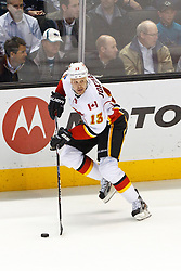 Jan 17, 2012; San Jose, CA, USA; Calgary Flames center Olli Jokinen (13) skates with the puck against the San Jose Sharks during the overtime period at HP Pavilion. San Jose defeated Calgary 2-1 in shootouts. Mandatory Credit: Jason O. Watson-US PRESSWIRE