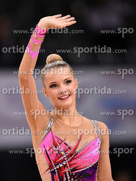 09.09.2015, Porsche Arena, Stuttgart, GER, Gymnastik WM, im Bild Laura Jung (GER) Band winkt bedankt sich bei Publikum Zuschauern nach gelungener UebungEmotion Glueck gluecklich // during the World Rhythmic Gymnastics Championships at the Porsche Arena in Stuttgart, Germany on 2015/09/09. EXPA Pictures &copy; 2015, PhotoCredit: EXPA/ Eibner-Pressefoto/ Weber<br /> <br /> *****ATTENTION - OUT of GER*****