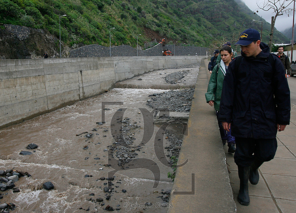 Portuguese marines search for bodies Thursday, Feb. 25 2010, in Ribeira Brava, some 15 kilometers (10 miles) outside Funchal, the Madeira Island's capital. Local authorities have increased to 29 the number of people reported missing in the Portuguese island's deadly landslides last weekend.Photo Gregorio Cunha