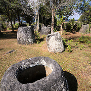 Cluster of the hollow stone jars at Site 3 of the Plain of Jars in north-central Laos. Much remains unknown about the age and purpose of the thousands of stone jars clustered in the region. Most accounts date them to at least a couple of thousand years ago and theories have been put forward that they were used in burial rituals.