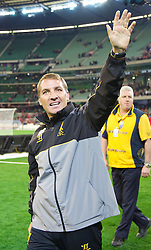 MELBOURNE, AUSTRALIA - Wednesday, July 24, 2013: Liverpool's manager Brendan Rodgers waves to the supporters after his side's 2-0 victory over Melbourne Victory during a preseason friendly match at the Melbourne Cricket Ground. (Pic by David Rawcliffe/Propaganda)