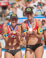 03.08.2013, Klagenfurt, Strandbad, AUT, A1 Beachvolleyball EM 2013, Finale Damen, Spiel 72, im Bild Beachvolleyball Europameisterinnen 2013 Stefanie Schwaiger 1 AUT / Doris Schwaiger 2 AUT // during Gold Medal Match match 72 of the A1 Beachvolleyball European Championship at the Strandbad Klagenfurt, Austria on 2013/08/03. EXPA Pictures © 2013, EXPA Pictures © 2013, PhotoCredit: EXPA/ Mag. Gert Steinthaler
