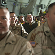 Ahmed Chalabi, member of the Iraqi Governing Council, listens as Pres. Bush spends Thanksgiving dinner with troops of the 1st Armor Division in a mess hall at Baghdad International Airport Thursday, November 27, 2003.  In a clandestine night time move President Bush, with the knowledge of only a handful of senior staff, departed his ranch in Crawford, Texas and flew through the night to spend the Thanksgiving Day holiday visiting troops stationed in the war torn country...Photo by Khue Bui