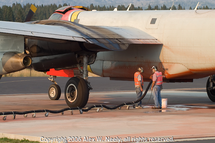 Airtanker 55, a Lockheed P2V Neptune owned and operated by Minden Air Inc., is reloaded with fire retardant at the US Forest Service Tanker Base in McCall, ID during the 2006 fire season in the Payette National Forest in Idaho.