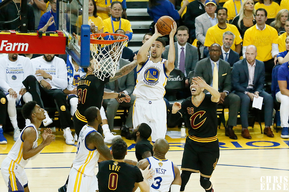 12 June 2017: Golden State Warriors guard Klay Thompson (11) takes a jump shot over Cleveland Cavaliers guard Deron Williams (31) during the Golden State Warriors 129-120 victory over the Cleveland Cavaliers, in game 5 of the 2017 NBA Finals, at the Oracle Arena, Oakland, California, USA.