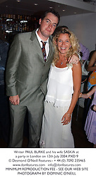 Writer PAUL BURKE and his wife SASKIA at a party in London on 12th July 2004.PXD 9