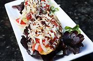 BRENDAN FITTERER  |  VISIT FLORIDA<br /> Goat Cheese Bruschetta with marinated tomatoes, fresh basil-pesto goat cheese on grilled rustic bread, basil olive oil, aged balsamic drizzle, and shredded aged parmesan at Mattison's City Grille downtown Sarasota, 1 North Lemon Ave Sarasota, FL 34236.