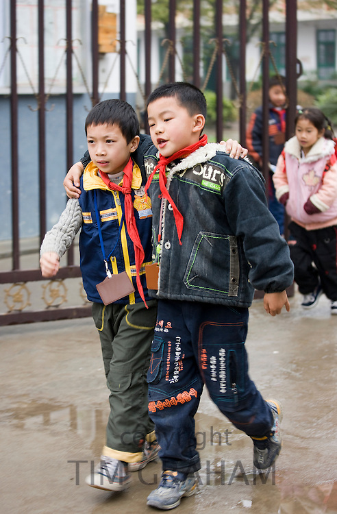Young boys leave the playground of a primary school in Fuli. China has a one child policy to limit population.