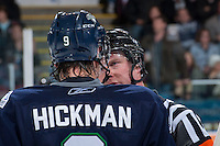 KELOWNA, CANADA - APRIL 3: Brett Iverson, referee, speaks to Justin Hickman #9 of the Seattle Thunderbirds on April 3, 2014 during Game 1 of the second round of WHL Playoffs at Prospera Place in Kelowna, British Columbia, Canada.   (Photo by Marissa Baecker/Getty Images)  *** Local Caption *** Brett Iverson; Justin Hickman;