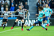 Joselu (#21) of Newcastle United passses the ball away from Nathan Ake (#5) of AFC Bournemouth during the Premier League match between Newcastle United and Bournemouth at St. James's Park, Newcastle, England on 4 November 2017. Photo by Craig Doyle.