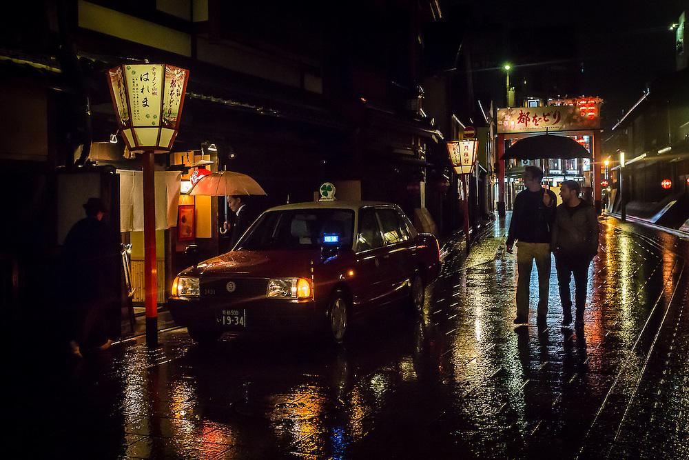 The traditional Hanami Koji street after a rain shower.