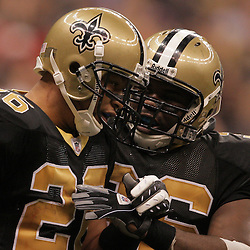 2008 November, 24: New Orleans Saints FB Darian Barnes (36) congratulates New Orleans Saints running back Deuce McAllister (26) after he scored a touchdown during 51-29 victory by the New Orleans Saints over the Green Bay Packers on Monday Night Football at the Louisiana Superdome in New Orleans, LA.
