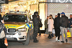 © Licensed to London News Pictures. 24/11/2017. London, UK. Armed police at The scene at on Oxford Street after police responded to an incident. People have been advised to stay inside shops. Armed police are on the scene. Photo credit: Ben Cawthra/LNP