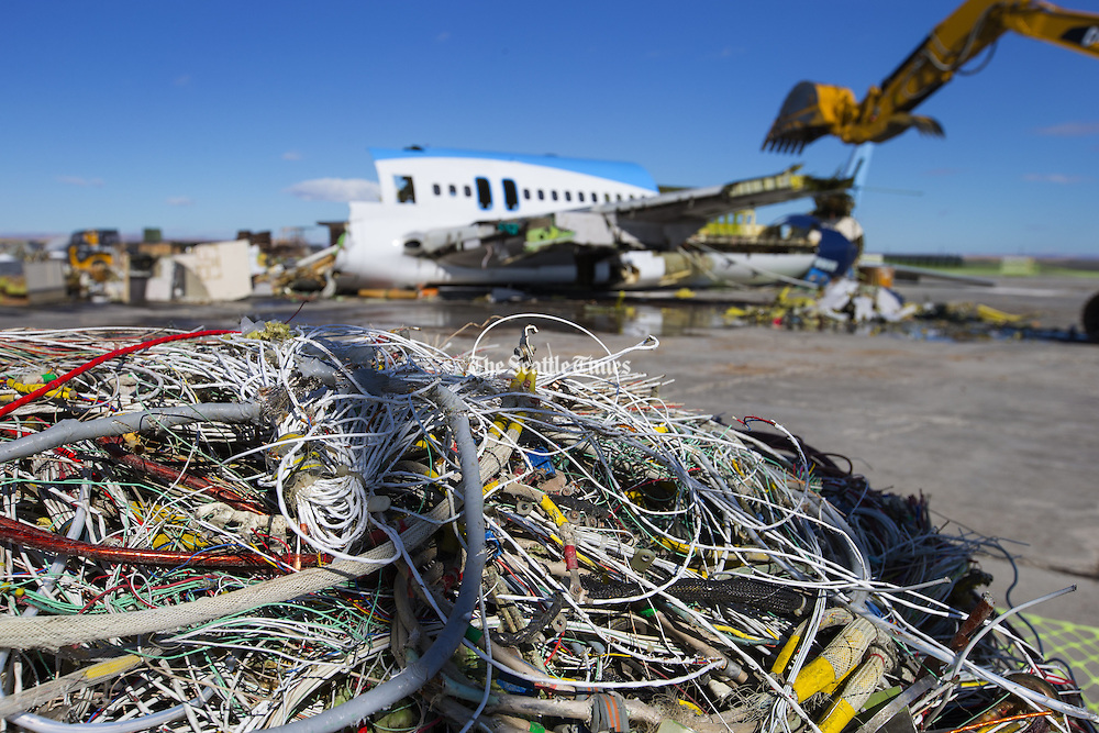 Wires from the 757 are put aside for recycling as the rest of the plane is being torn apart. <br />