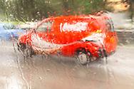 Coca-Cola delivery truck in the rain, Singapore.