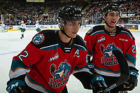 KELOWNA, BC - SEPTEMBER 28:  Dillon Hamaliuk #22 and Liam Kindree #26 of the Kelowna Rockets skate to the bench to celebrate a goal against the Everett Silvertips at Prospera Place on September 28, 2019 in Kelowna, Canada. (Photo by Marissa Baecker/Shoot the Breeze)