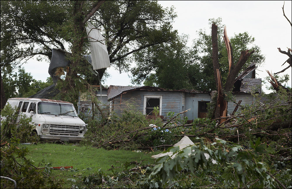 An EF-2 tornado threw debris into trees, tree branches scattered about, and destroying homes in Eureka, Kansas.