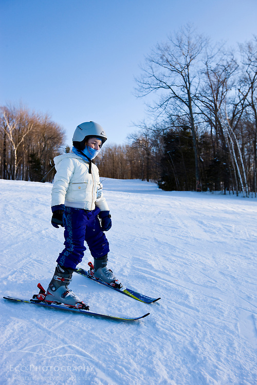 A young skier at Jiminy Peak ski resort in the Berkshire Mountains in Hancock, Massachusetts.