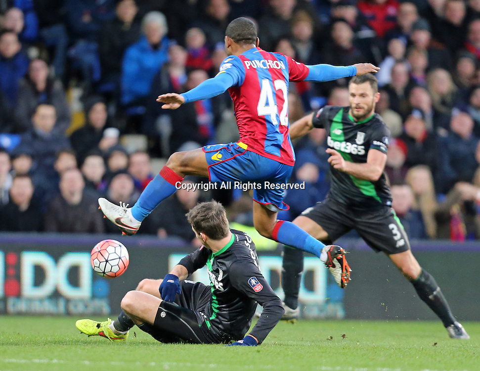30.01.2016. Selhurst Park, London, England. Emirates FA Cup 4th Round. Crystal Palace versus Stoke. Jason Puncheon jumps over Philipp Wollscheid as Erik Pieters looks on
