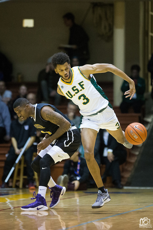 San Francisco Dons guard Ronnie Boyce (3) dribbles past the San Francisco State University Gators defense at Kezar Pavilion in San Francisco, Calif., on December 6, 2016. (Stan Olszewski/Special to S.F. Examiner)