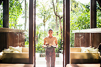 Coconut products and a spa room overlooking a vast forest of coconut trees at the Four Seasons in Koh Samui, Thailand.
