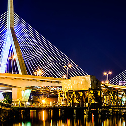 Panorama photo of Boston Bunker Hill Zakim Bridge at night. The Leonard P. Zakim Bunker Hill Memorial Bridge is a cable bridge that spans the Charles River in Boston, Massachusetts in the Eastern United States. Panorama photo ratio is 1:3.