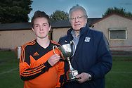 St John's captain Ben Russell receives the George Grant Memorial Trophy from DFCSS' Dave Forbes - Grove (white) v. St.John's (tangerine) in the U17 George Grant Memorial Trophy Final (sponsored by DFCSS) at Whitton Park, Dundee, Photo: David Young<br /> <br />  - &copy; David Young - www.davidyoungphoto.co.uk - email: davidyoungphoto@gmail.com