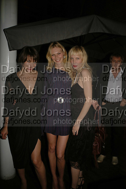 Milla Jovavich, Shirely Mallmann and Carmen Hawk, MILLA JOVOVICH, CARMEN HAWK & HARVEY NICHOLS CELEBRATE THE LAUNCH OF JOVOVICH-HAWK. FIFTH FLOOR CAFƒ. HARVEY NICHOLS. london.  27 April 2006. ONE TIME USE ONLY - DO NOT ARCHIVE  © Copyright Photograph by Dafydd Jones 66 Stockwell Park Rd. London SW9 0DA Tel 020 7733 0108 www.dafjones.com